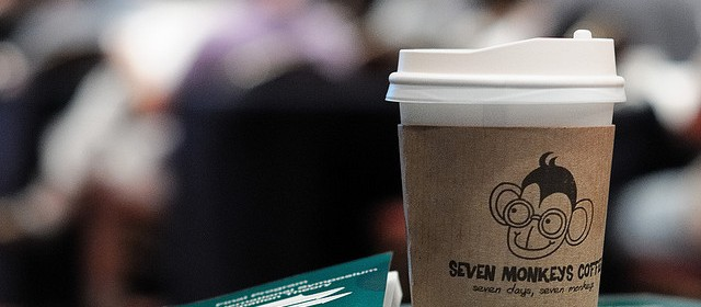 photo from a conference: coffee cup and books