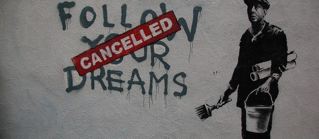 "Banksy stencil on wall: ""Follow Your Dreams"" with ""Cancelled"" crossing it out"