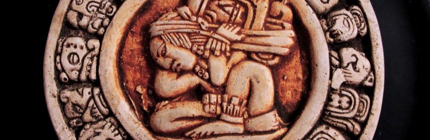 A carving of a circular Mayan calendar